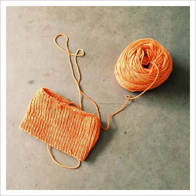 orange Heel Stitch Hat knitting in progress